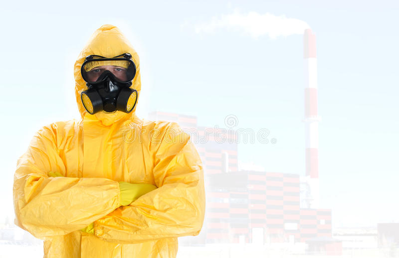 Worker in protective chemical suit. Space for your text stock photography