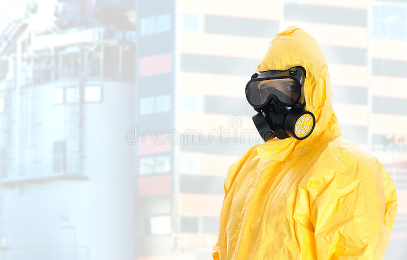 Worker in protective chemical suit. Space for your text stock photos