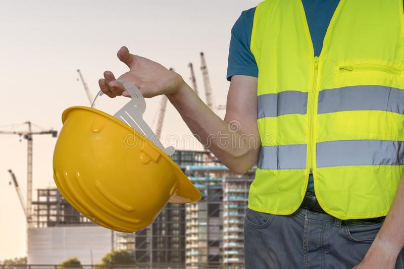 Worker with protective helmet on construction site. royalty free stock photos