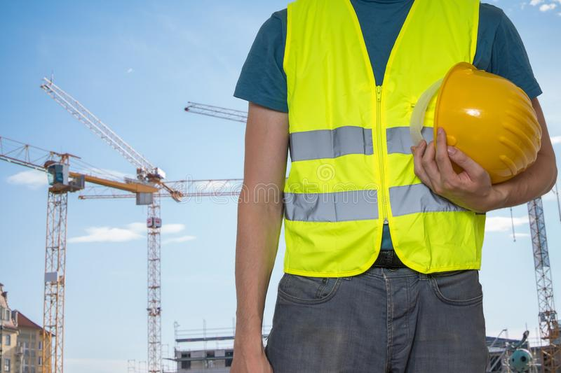 .Worker with protective helmet on construction site stock photos