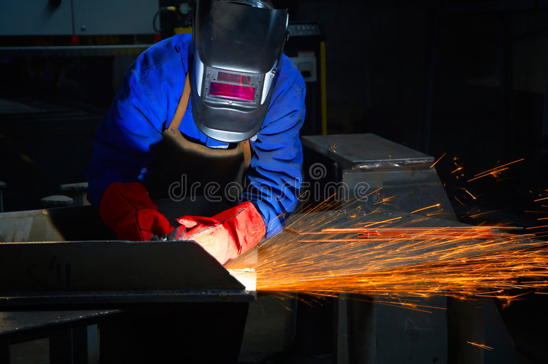 Worker with protective mask and gloves grinding royalty free stock photos