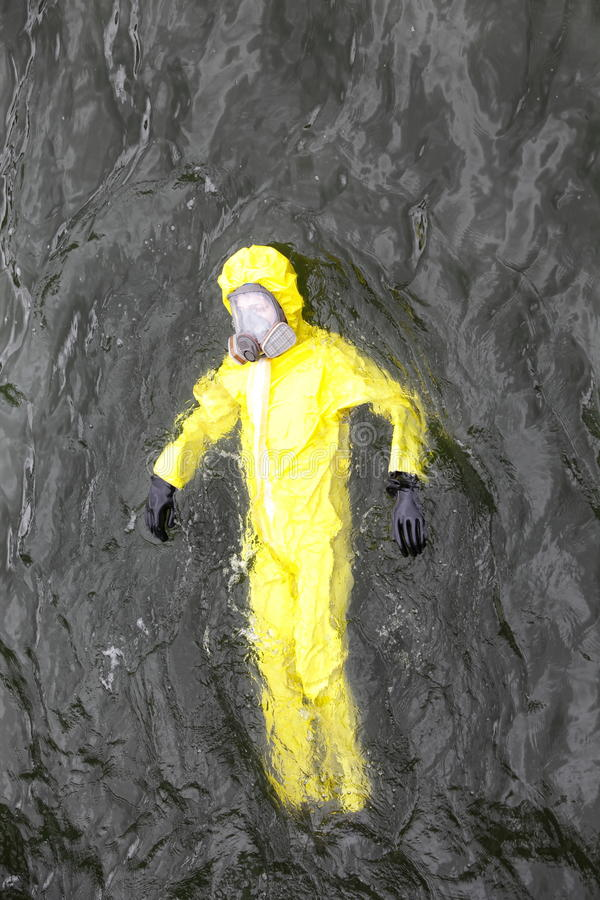 Worker in protective suit in water royalty free stock photography