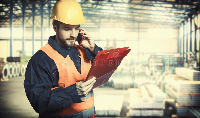 Worker in protective uniform and protective helmet stock photo
