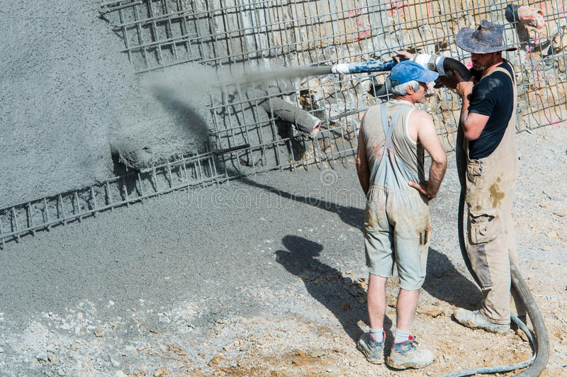 Worker pumping concrete stock photo