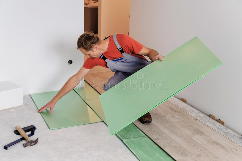 Worker puts the pieces underlaymen royalty free stock photography
