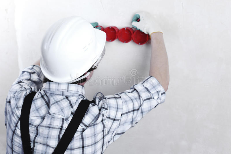 Worker puts the wires royalty free stock image