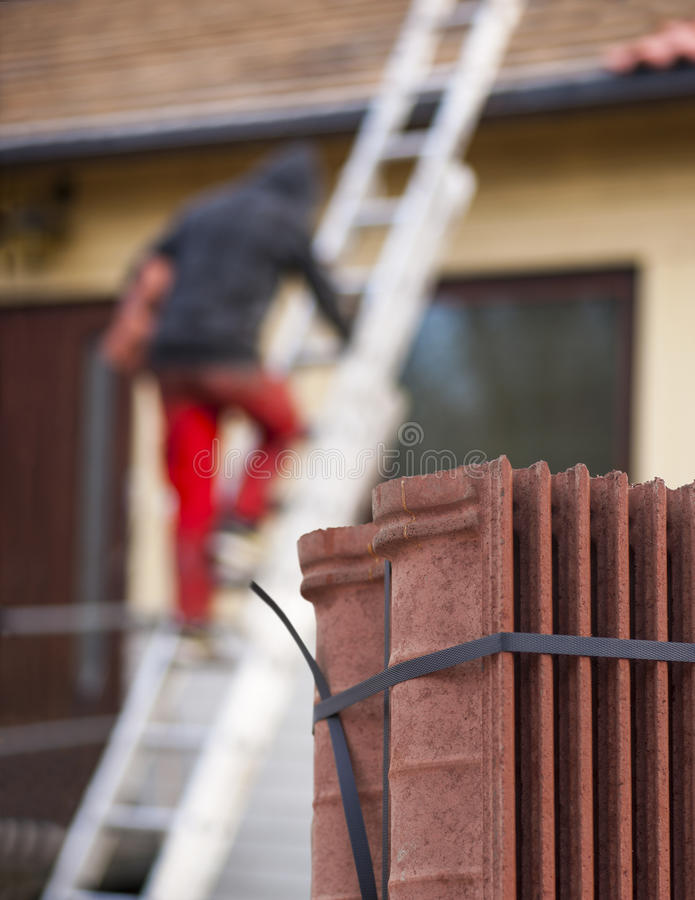 Download Worker Putting New Roof Tiles On House Stock Photo - Image of blurred, renovation: 39508496