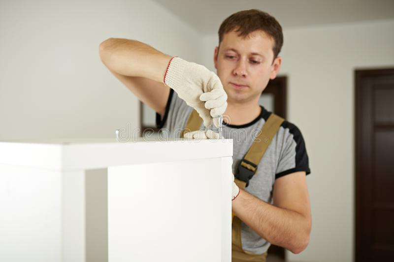 Worker putting in cabinet royalty free stock photography