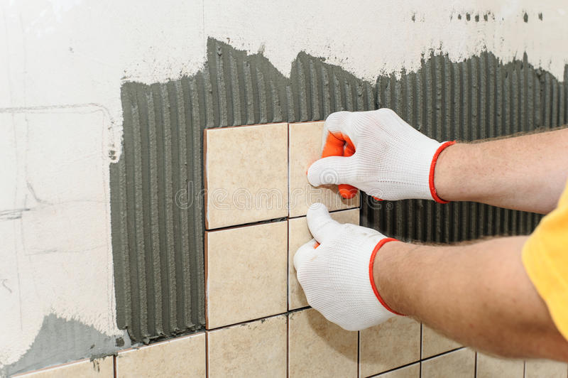 Worker Putting Tiles On The Wall In The Kitchen. Stock Photo - Image ...