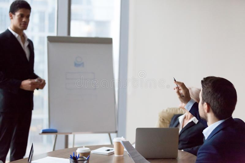 Worker raises hand to ask business coach royalty free stock photography