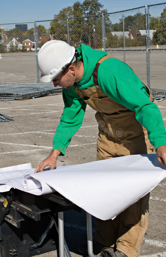 Worker Reading Blueprints Royalty Free Stock Image
