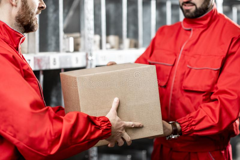 Warehouse worker with package royalty free stock images