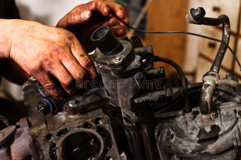 Download Worker Repairing Broken Engine Stock Photo - Image: 23621650