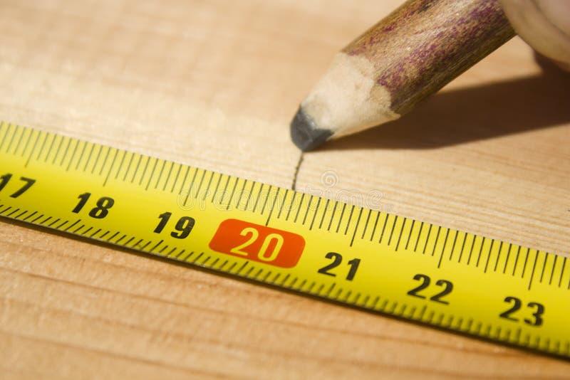 Marking distances. The carpenter`s hands measure distance measure. stock images