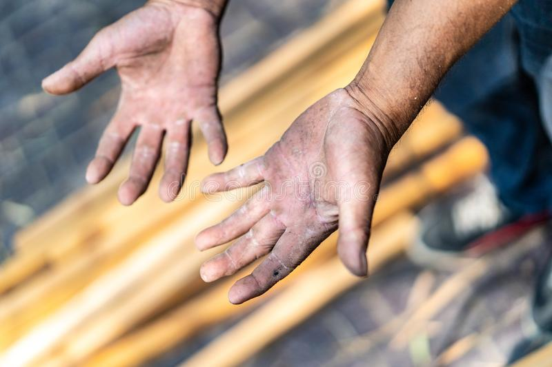 Worker`s hand very hard working in the field of construction carpenter and smith. Worker`s hand very hard working in the field of  construction carpenter and stock images