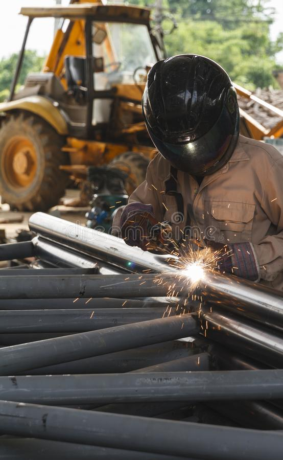Worker with safety equipment and protective mask welding. Worker with safety equipment and protective mask welding steel, Steel structure manufacturing royalty free stock photo