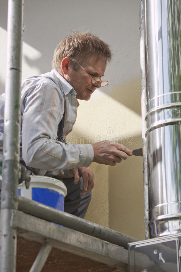 Worker On Scaffold Royalty Free Stock Photography