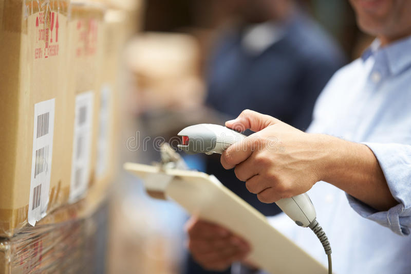 Worker Scanning Package In Warehouse royalty free stock photos