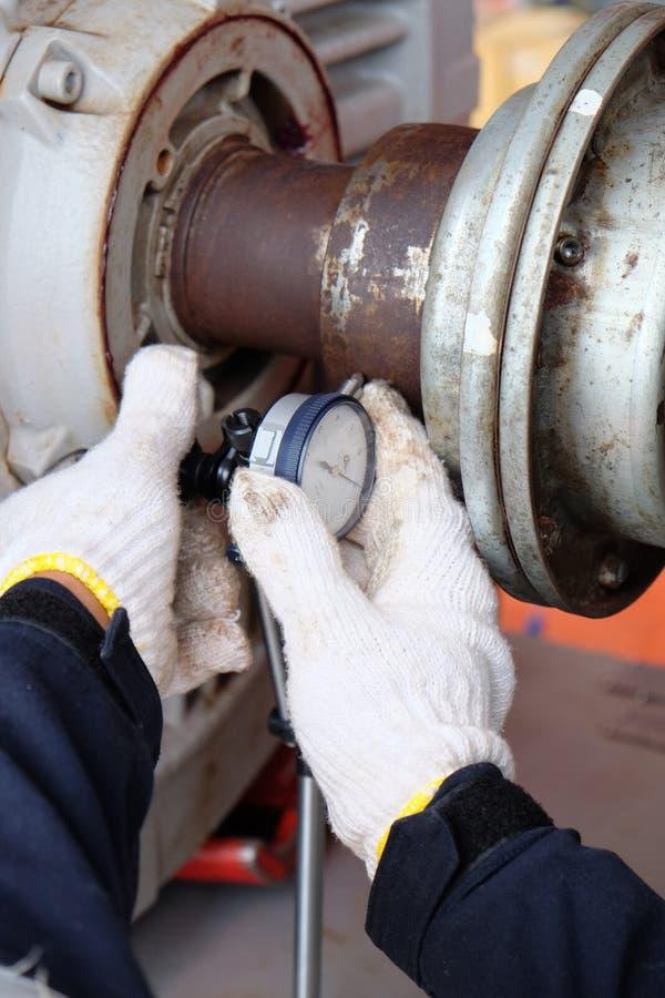 Worker set up Dial Indicator Gauge. Worker set up Dial Indicator Gauge for alignment shaft stock photos