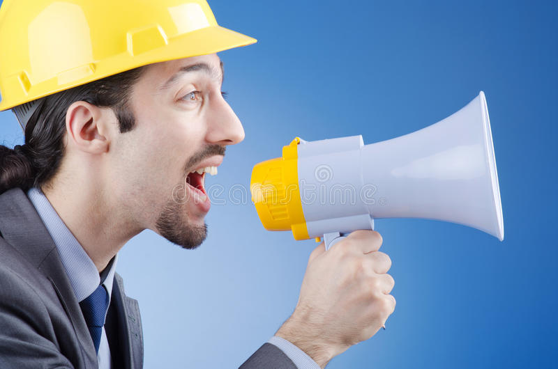 Worker shouting via loudspeaker