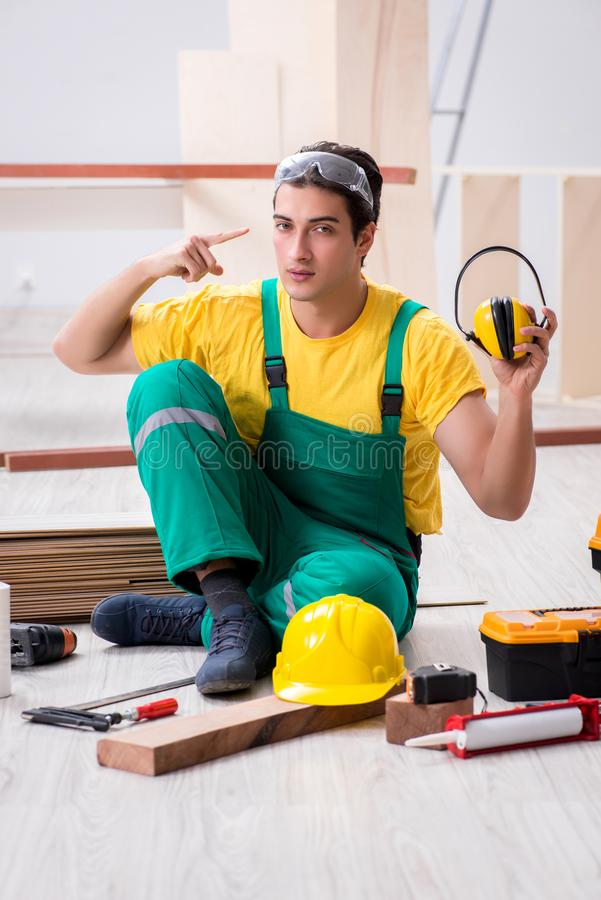 Worker showing the importnace of wearing noise cancelling headph. Ones royalty free stock photography