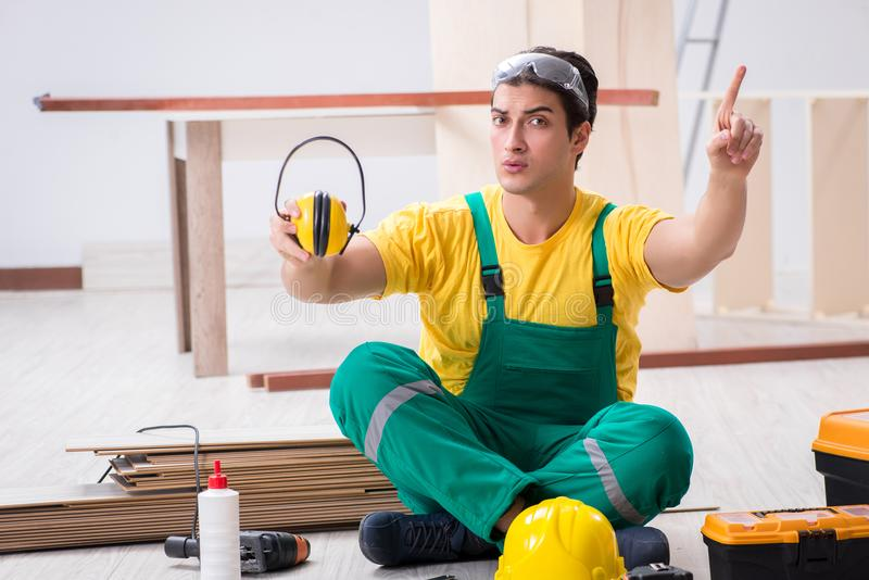 Worker showing the importnace of wearing noise cancelling headph stock image