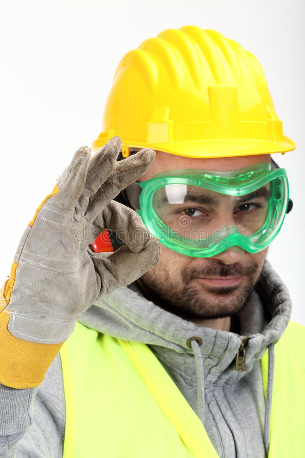 Worker showing OK sign stock image