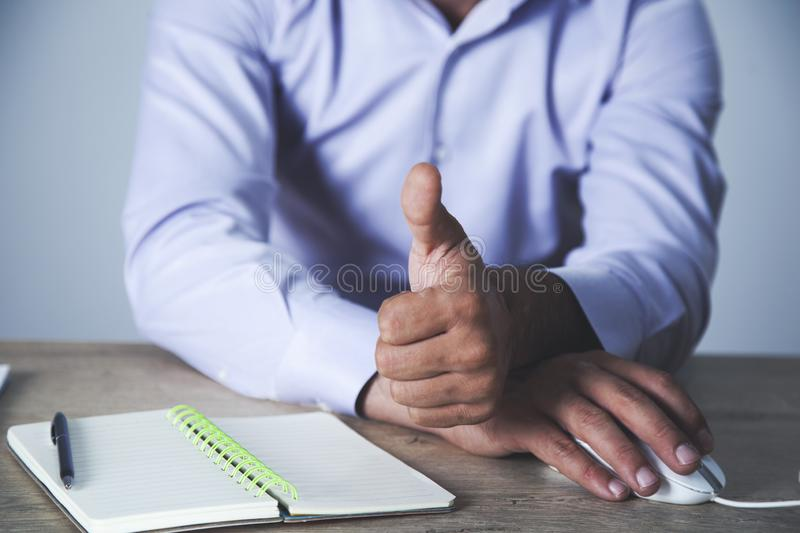 Worker showing thumb up stock images