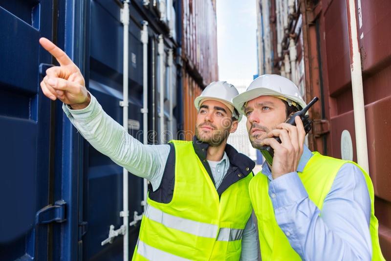 Worker shows to supervisor security system setting up royalty free stock images