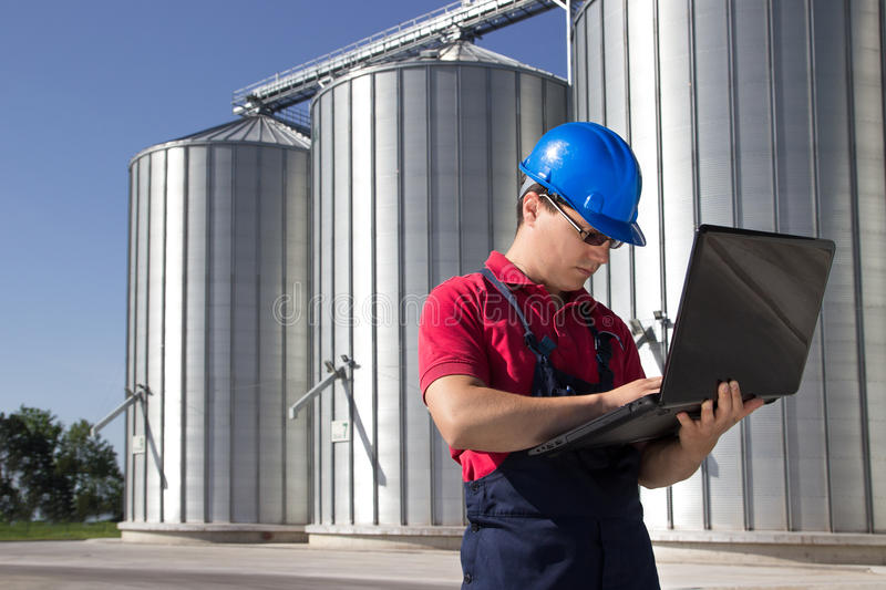 Worker in silo company stock photos