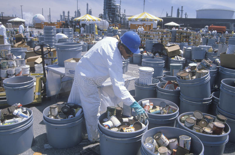 Worker sorting toxic wastes. At waste cleanup site on Earth Day at the Unocal plant in Wilmington, Los Angeles, CA stock images