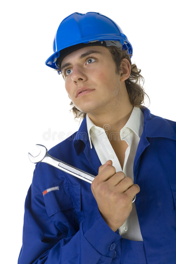 Worker with spanner. Young worker in blue workwear holding spanner in hand. White background stock photos