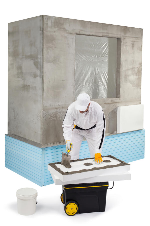 Download Worker Spreading A Putty On An Insulation Panel Stock Photo - Image: 33942942