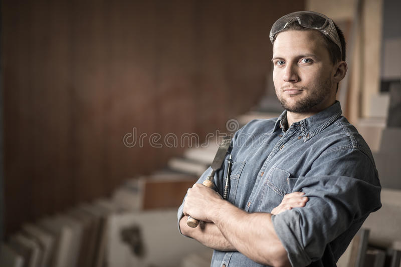 Worker standing with a chisel royalty free stock photo