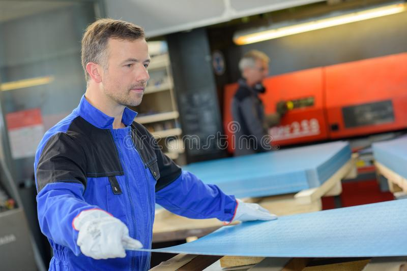 Worker at steel factory. Young royalty free stock image