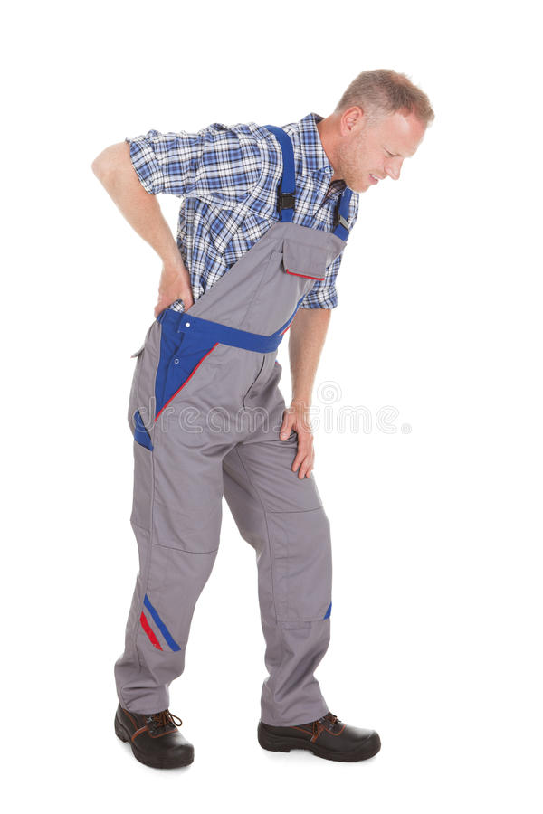 Worker suffering from back pain royalty free stock photography