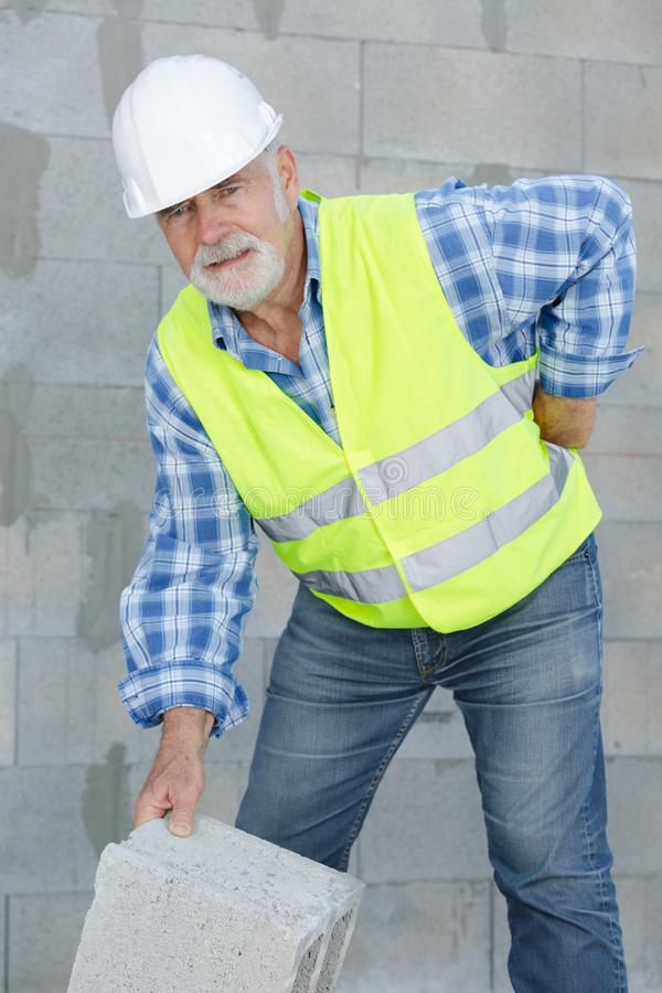 Worker suffering from pain in back royalty free stock images
