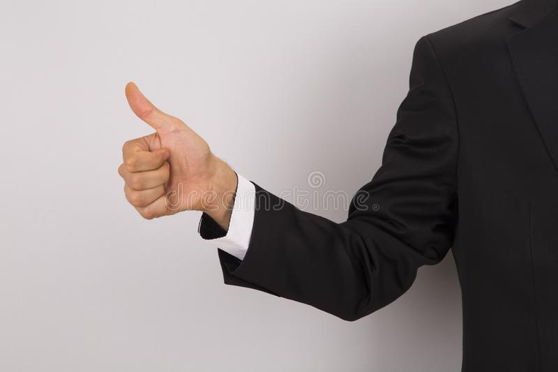 Worker in suit doing okey sign royalty free stock images