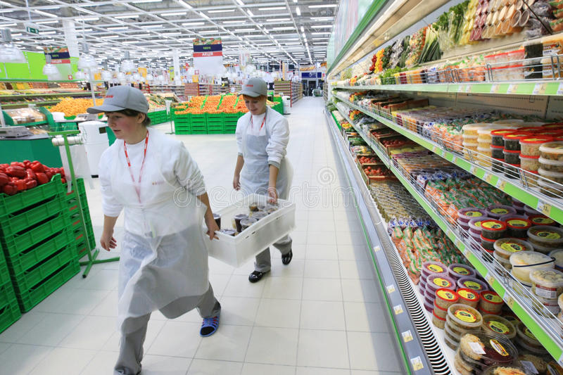 Worker in supermarket royalty free stock image