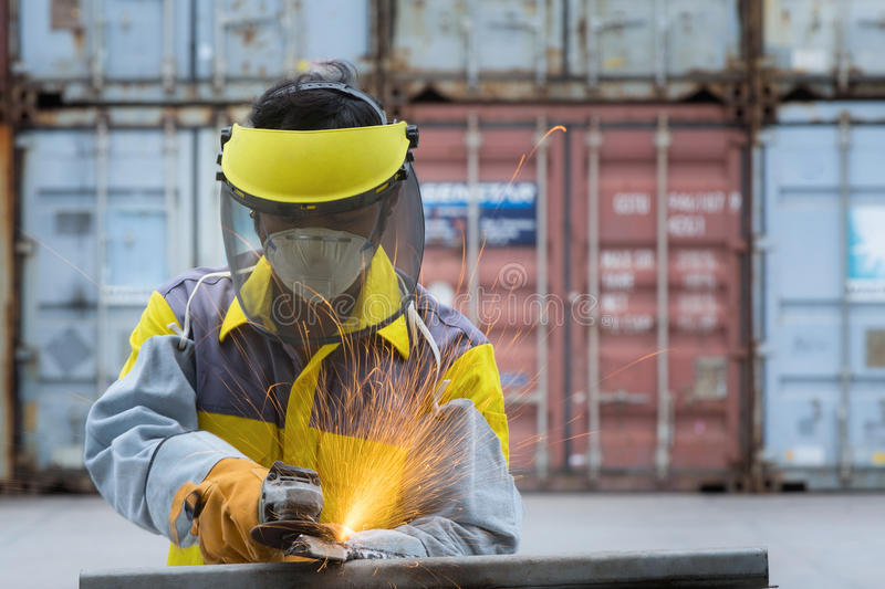 Worker take hard work with Electric wheel grinding royalty free stock photo