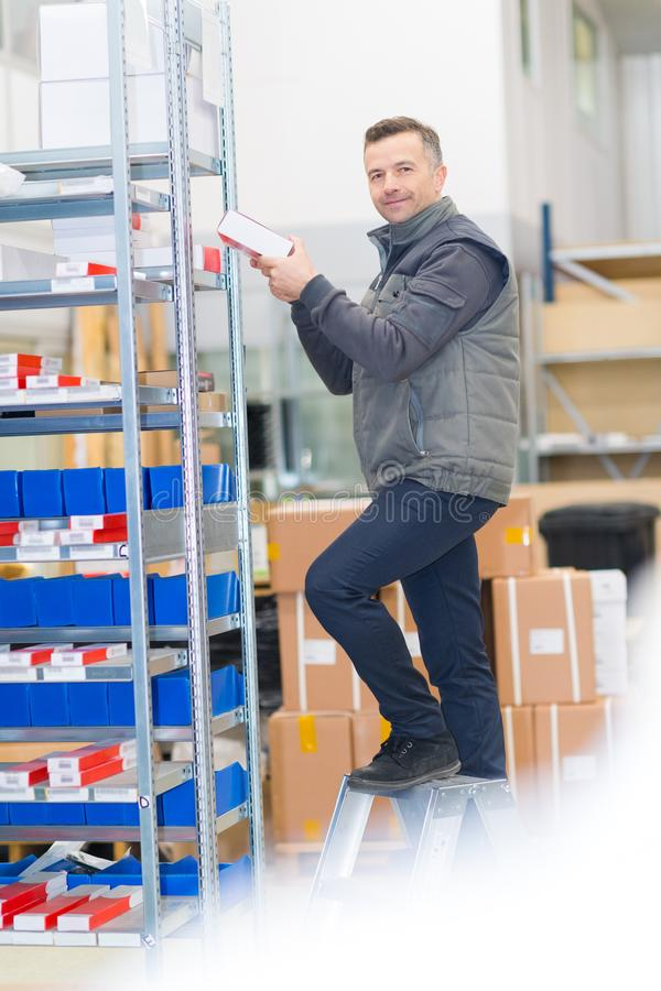 Worker taking product on top stock photos