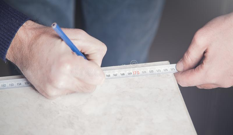 Worker with a tape measure and pencil stock photography