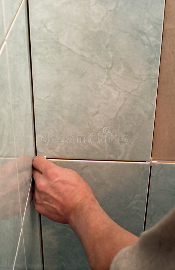Worker tiling wall stock images