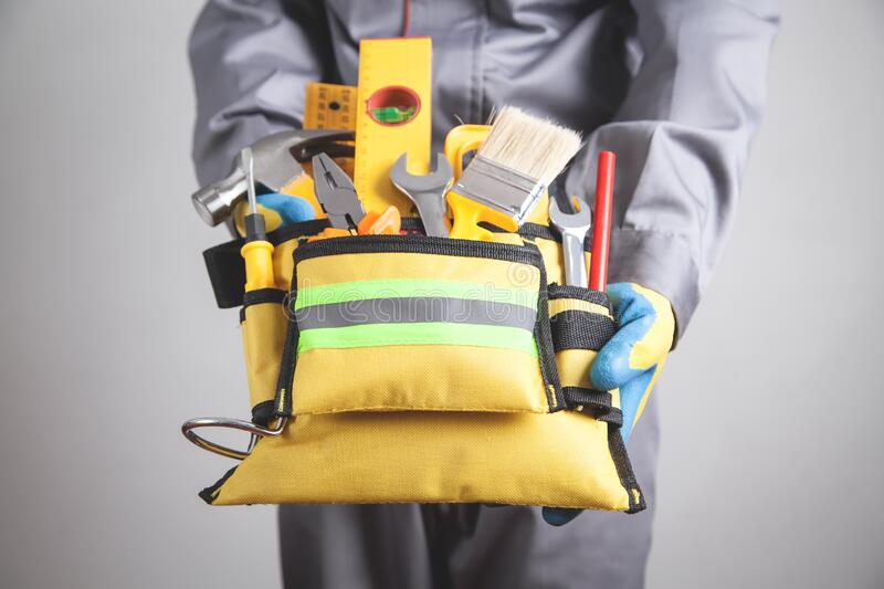 Worker with a tool belt. Construction tools royalty free stock images