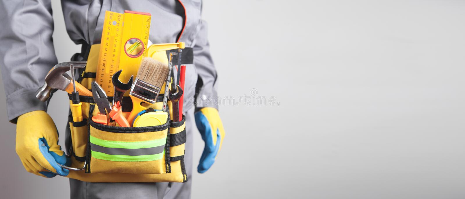 Worker with a tool belt. Construction tools royalty free stock photos