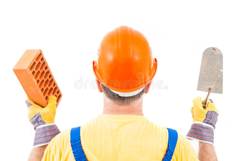 Worker With Trowel and Brick in Hands royalty free stock image