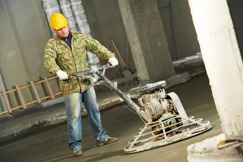 Worker trowelling and finishing of concrete royalty free stock photo