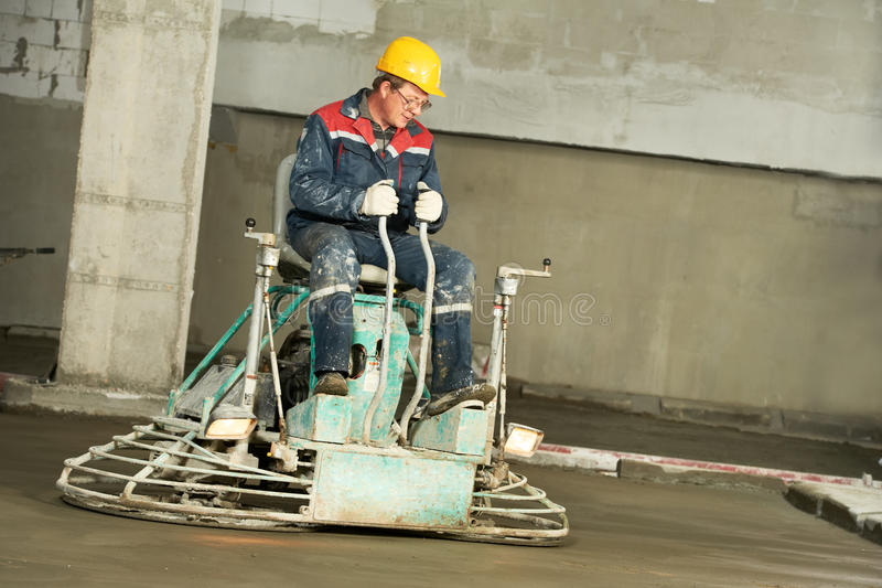 Worker trowelling and finishing of concrete royalty free stock images