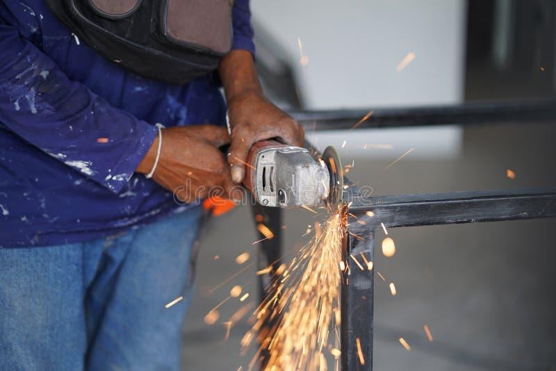 Worker use grinder steel cutting create metal steel table. Technician industrial. royalty free stock image