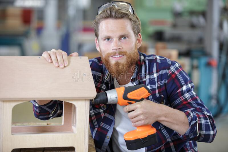 Worker uses with drill stock photo